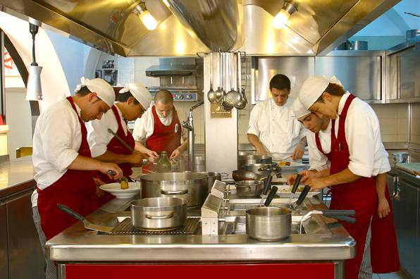 The beautiful open kitchen where Chef Nico Atrigna and his staff prepare the restaurant's signature dishes.