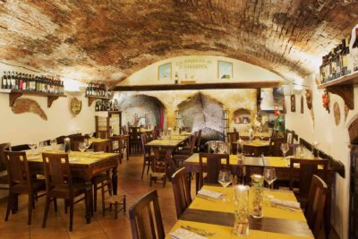 The evocative hand-sculpted walls of this unique dining hotspot make it one of the best Tuscany Restaurants.